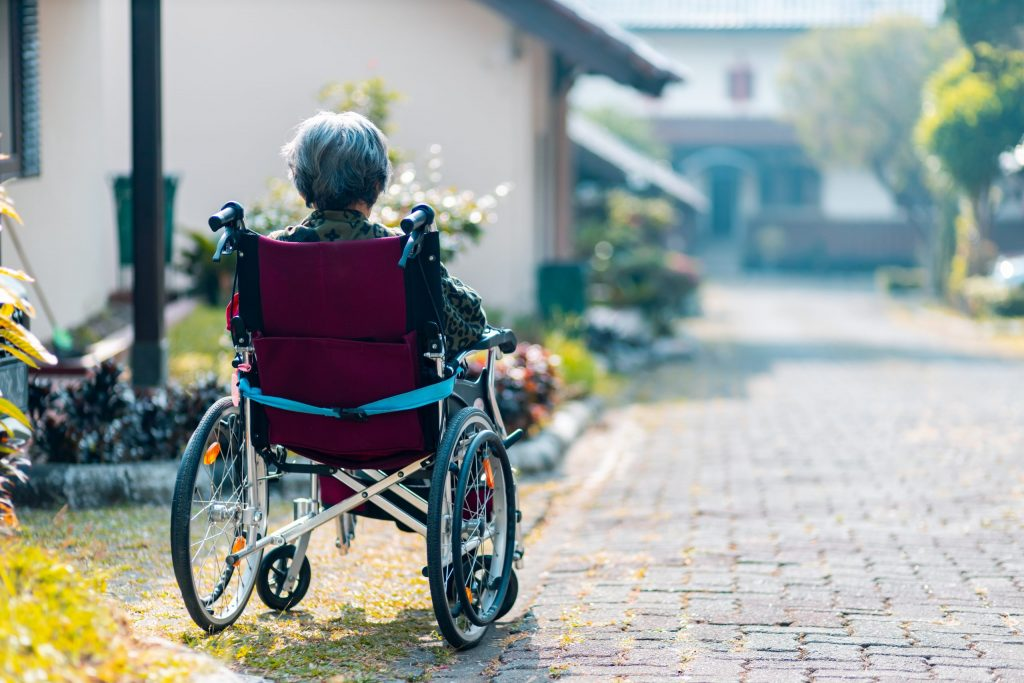 woman sitting on wheelchair
